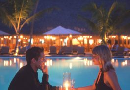 ber001374_16-couple-dining-poolside-sunset